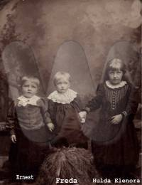 Ella Peterson Johnson's children: Hulda, Ernest, and Freda